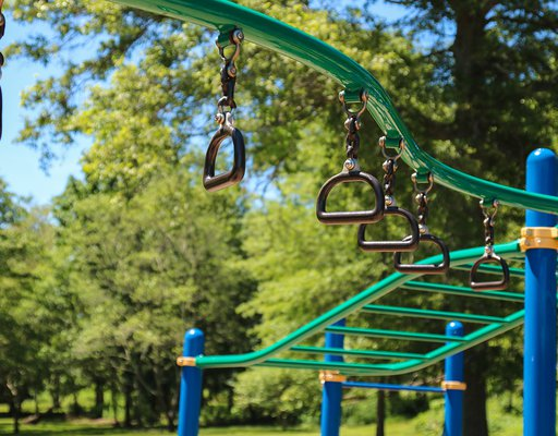 monkey bars and rings at the jungle gym playground.